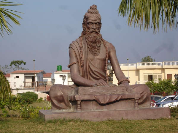 Statue of Patanjali with book