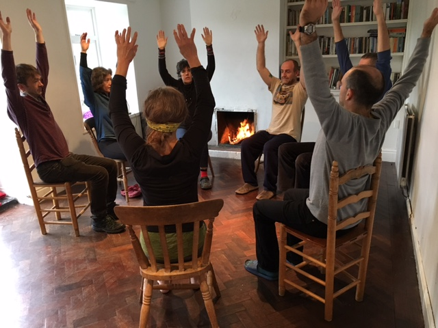 Chair Yoga with people sitting doing posture together